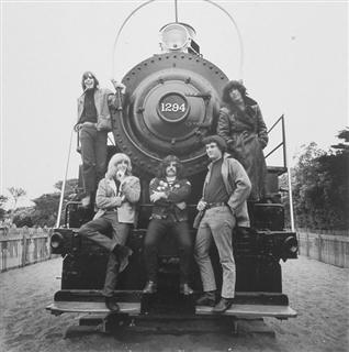 Grateful Dead at the San Francisco Zoo in 1966 by Herb Greene.