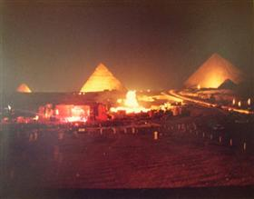 The stage for the Grateful Dead and the pyramids lit up at night