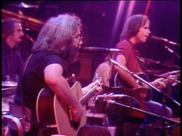 Jerry Garcia and Bob Weir playing acoustic guitars.